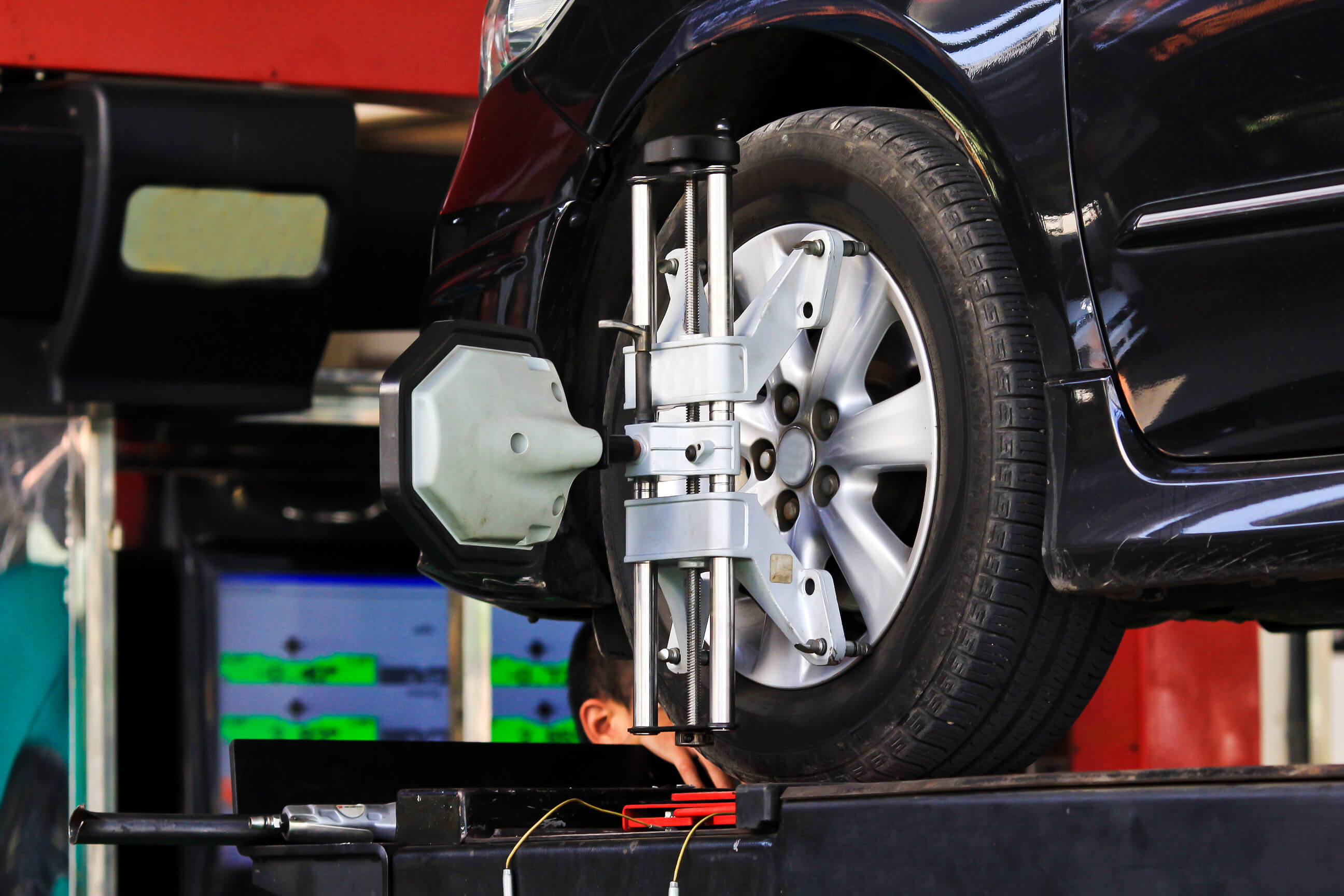 Free wheel alignment with tire installation service