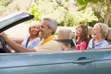 Adults driving in the summer, practicing summer driving safety tips